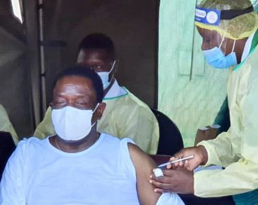 President Mnangagwa strips down to verse as he gets vaccinated