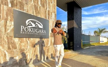 Musician Jah Praiser hired to officially open a gate by Sharpe